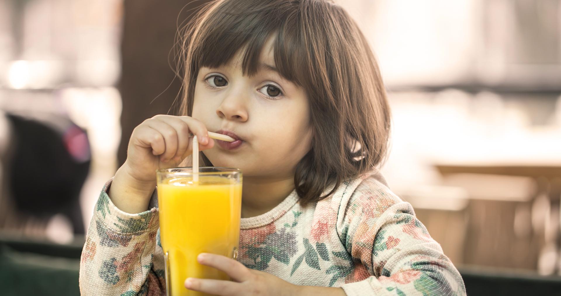 Little Cute Girl In A Cafe Is Drinking Orange Juice, Baby Food C